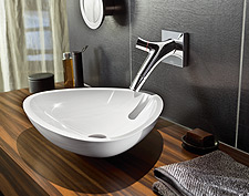 Stylish combination with wall spout from AXOR Starck Organic and wash bowl from the AXOR Massaud collection.