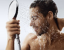 Showerhead hold by a man