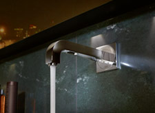 The electronic wall mixer from Axor Citterio conceals its sensor in the underside of the spout.