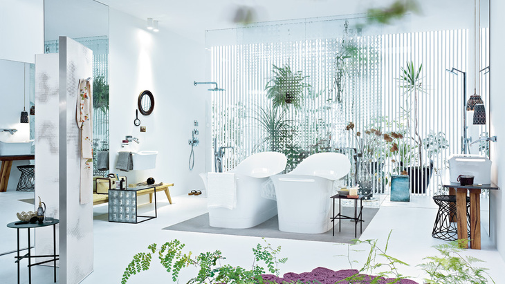 A feminine bathroom design combines multiple styles.