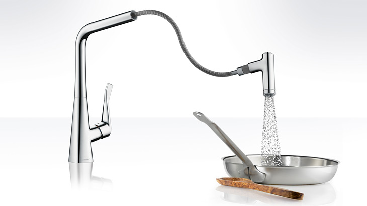 Metris kitchen faucet with swiveling spout and handspray.