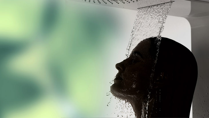 Showering fun in the Shower Rain: woman under a Raindance overhead shower