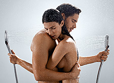 Man and woman embracing, with two Raindance Select hand showers
