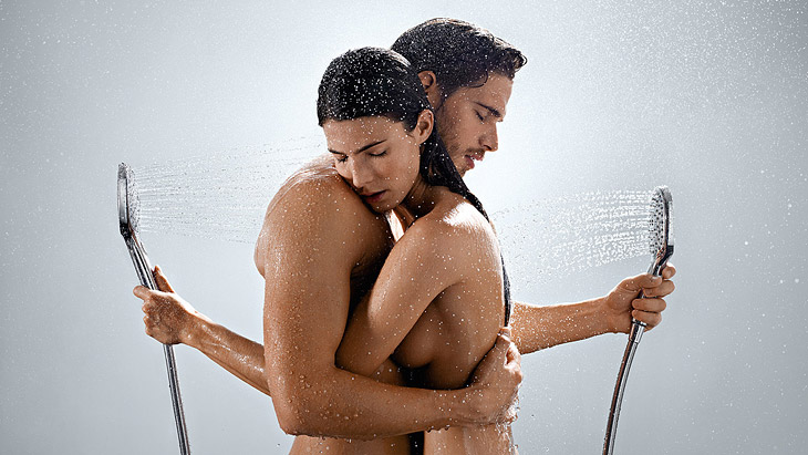 Couple with two hand showers