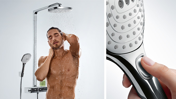 Man enjoys a shower with the Raindance Select Showerpipe E 300 – and switches jet types at the touch of a button.