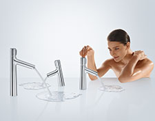 Woman with two Metris bathroom faucets