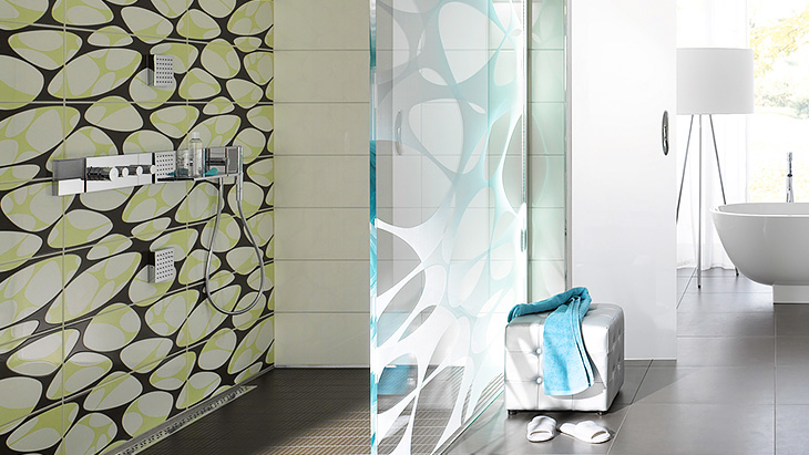 Decorative tiles in a floor-level shower.