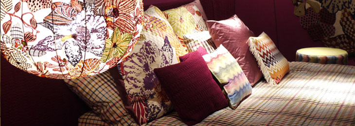 A colorful mix of patterns on the textiles gives the living space a brighter feel.