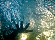 Underwater shot: Hand reaching out in the water