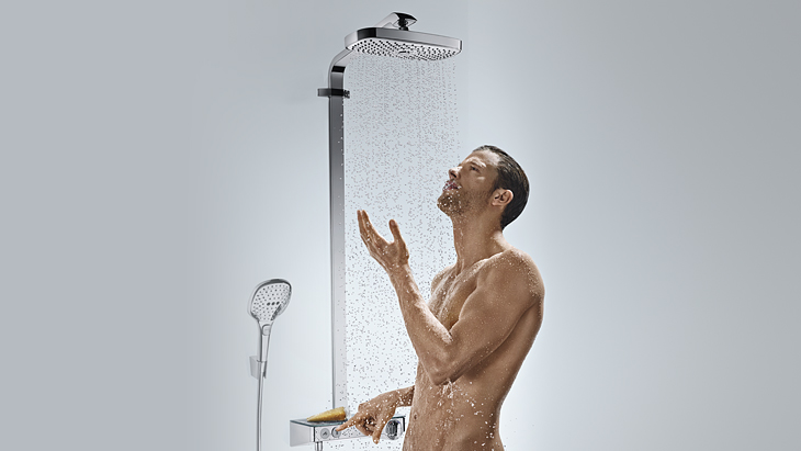 Man under shower system from hansgrohe.
