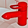 Red basin mixer Hansgrohe Uno.