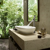 Axor Starck Organic two handle basin mixer for wash bowls next to the Palomba wash bowl from Laufen.