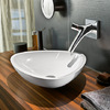 Axor Starck Organic two handle basin mixer for wall mounting at the Axor Massaud wash bowl.