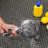 Removing limescale from a shower head