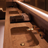 Wash basin featuring Axor Urquiola brushed gold.
