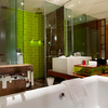Bright green tiles in the shower – a successful contrast to the brown of the tiles and marble. (W Hotel, Taipei)