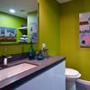 Wash basin in front of green wall.