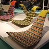 A new shell chair without feet – colorful style for indoors and outdoors with rocking motion. (Dedon)