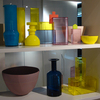 Small decorative objects such as these vases and bowls in yellow, blue, red and pink set the mood. As seen at Interluebke.