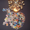 Trendy wall decoration: A collage of pictures and personal keepsakes also invigorates any bathroom. (Rolf Benz)
