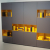 Open compartments in yellow offer a lively contrast in this modular furniture. As seen at Karat.