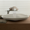 Organically-shaped wash basin and mixer with soft lines.