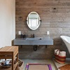 Wooden panels used as a wall covering in the bathroom