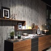 Sideboard in front of wall with wood cladding