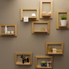 Wooden picture frames with little shelves are decorative details that improve the look of the bathroom.