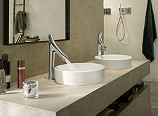Axor Starck Organic two handle basin mixers next to two wash bowls