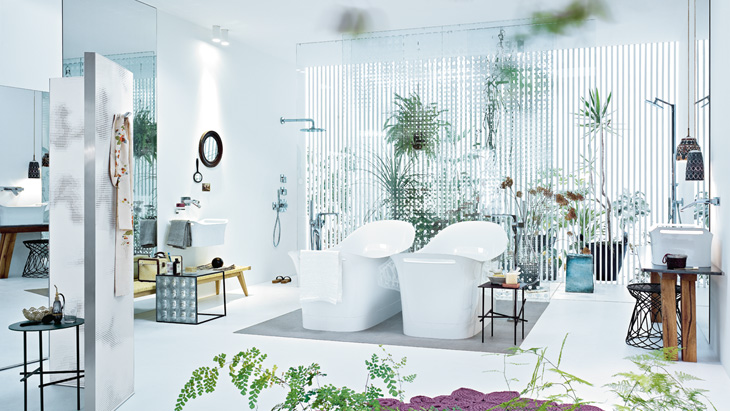 A bathroom with different areas of use: merging bathroom and bedroom.