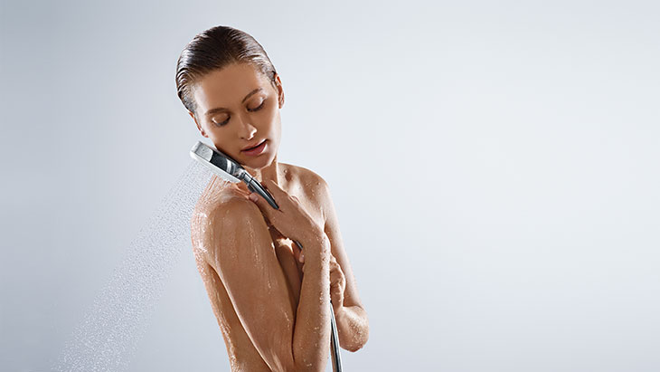 Woman with Crometta 100 hand shower