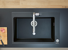 Graphite black granite sinks installed.