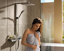 Woman under hansgrohe showerpipe