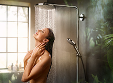 Woman showering with a hansgrohe PowderRain overhead shower.