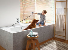 Boy showers with dog; sBox bath tub.