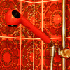 Red hand shower Hansgrohe Tribel.