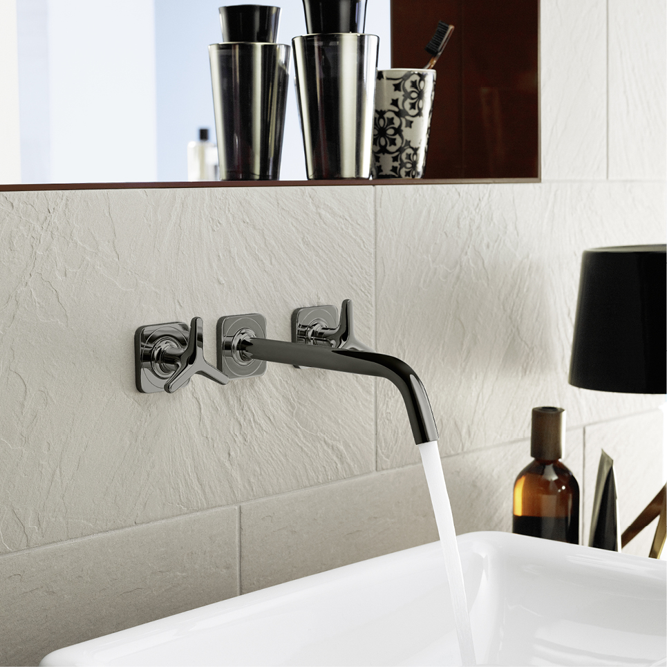 Polished black chrome wall mounted faucet by Hans Grohe