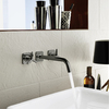 Axor Citterio wall-mounted faucet in black chrome.