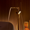 Axor Urquiola bath tub thermostat in gold finish.